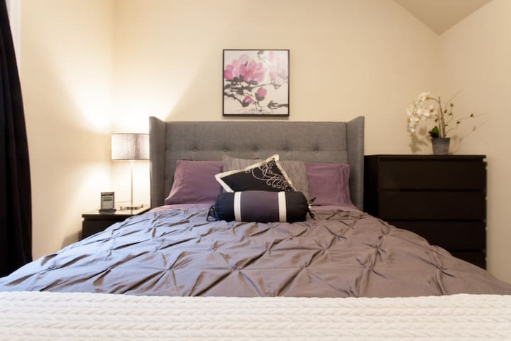 Sleep well in this comfy queen bed! A private bedroom and a new mattress and dark curtains should offer a great nights sleep!