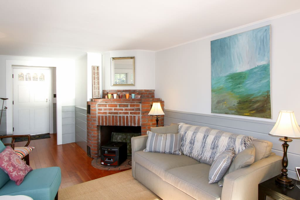 The living room provides comfortable seating for 5.