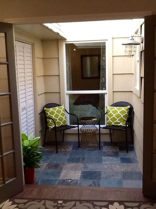 quaint indoor courtyard seating area and laundry room with washer/dryer