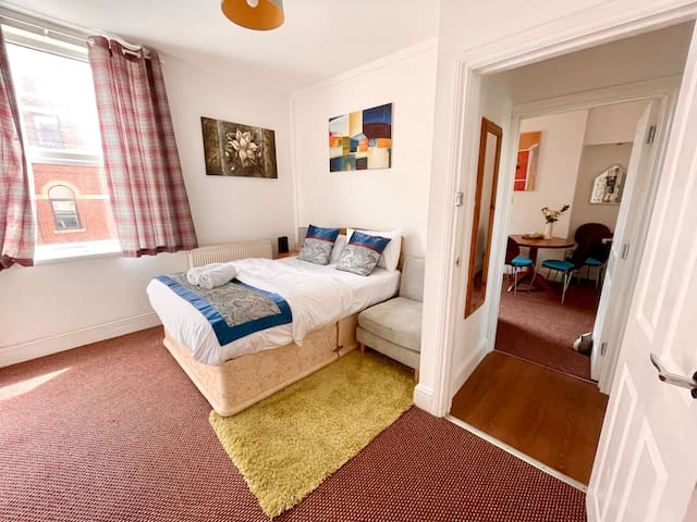 Bedroom 1:- Bright and airy , with usual refinements .