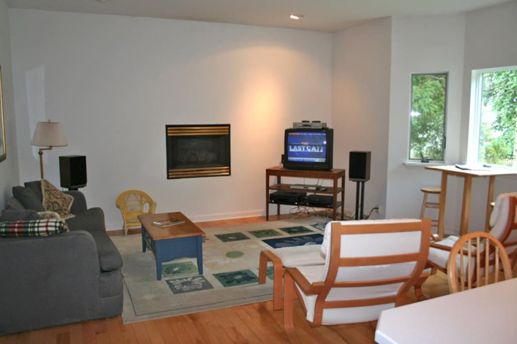 Enjoy the TV and fireplace in the sitting area next to the kitchen.
