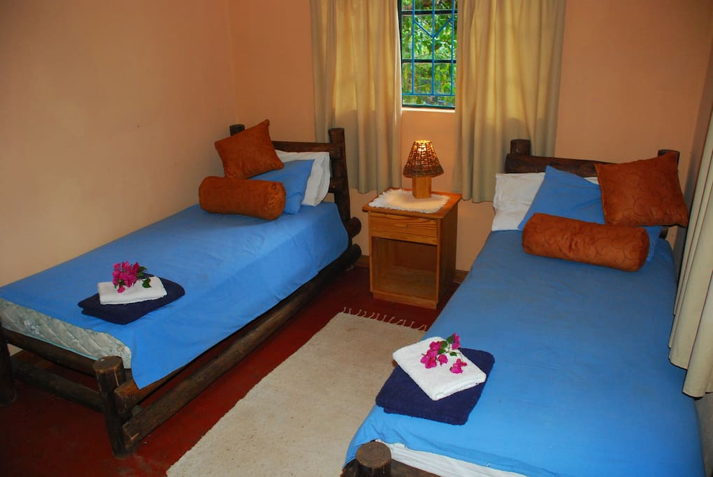 8 Twin Bed Rooms with fans & mozzie / security protection.