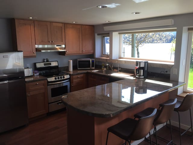 Full kitchen, stove, dishwasher, microwave, coffee maker, disposal, full size fridge, view of the Wrangell Narrows right outside.