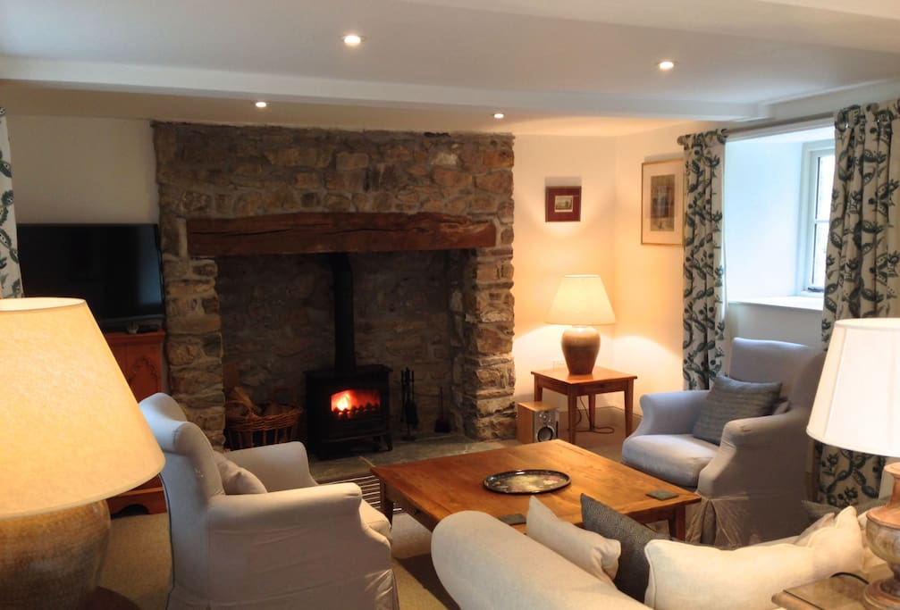 Ground floor:  Sitting room with multi fuel stove & beamed fireplace