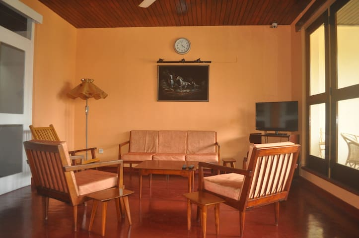 Spacious sitting room with cable TV.  This area opens out onto a large balcony with table and chairs.