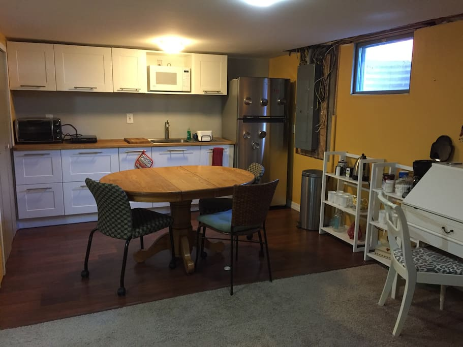 Kitchenette with full-size fridge, large toaster oven (cook a frozen pizza!), induction hot plate, coffee maker, electric tea kettle, plates, cups, silverware, and sink, all to yourself. Make a meal and pull up to the kitchen table!