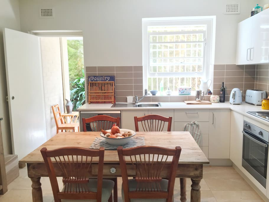 Country style kitchen. Help yourself to TV and food available.