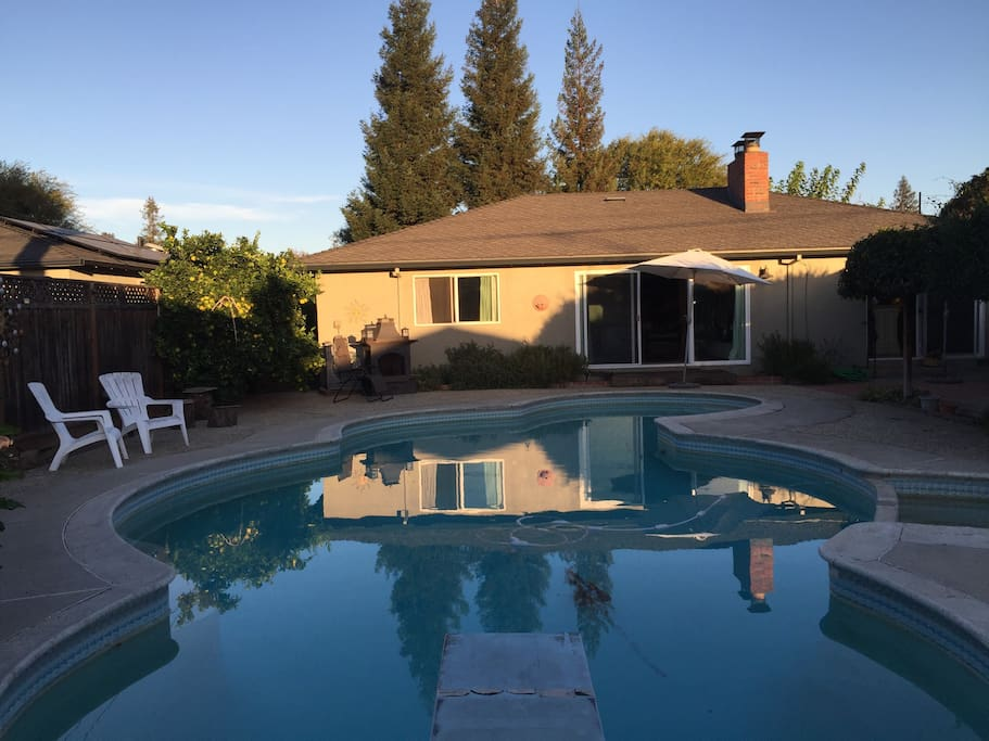 View of pool, back of the house and #2 outdoor fireplace