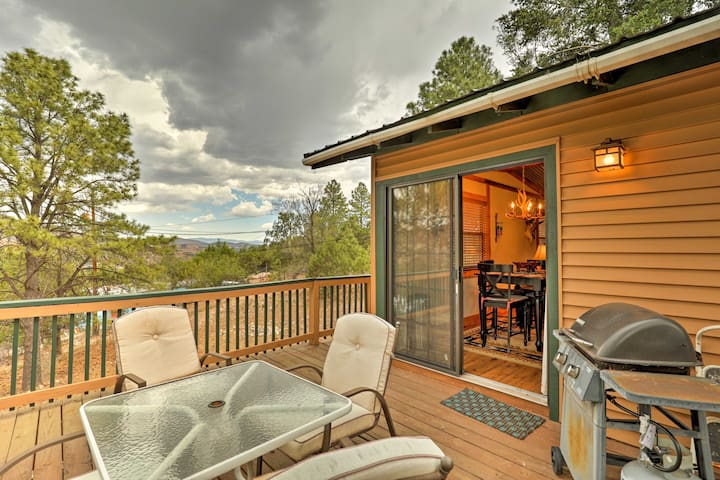 Peaceful wooded views are featured from the back deck.