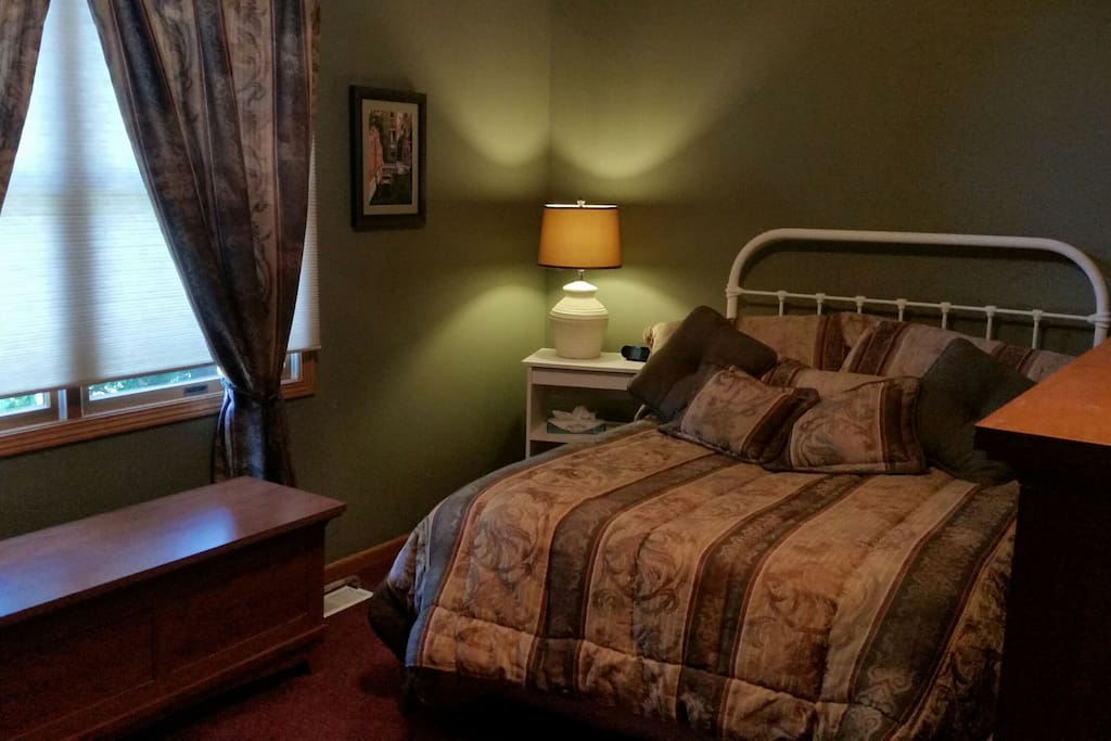 Double bed with large window for light. Pull down shades for privacy.