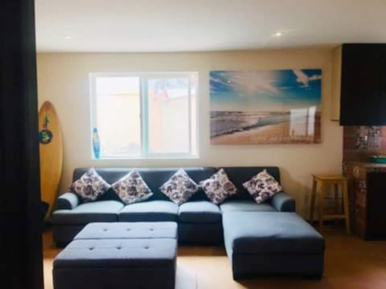 Large comfy couch perfect for entertaining, watching movies, or relaxing. Sleeps 1 adult and 1 small child- 2 Air mattresses also readily available to accommodate 2 extra guests