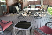 covered patio with outdoor table and chairs.