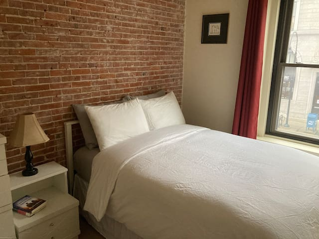 The bedroom features a full size bed with cotton sheets, extra pillows, and down comforter.