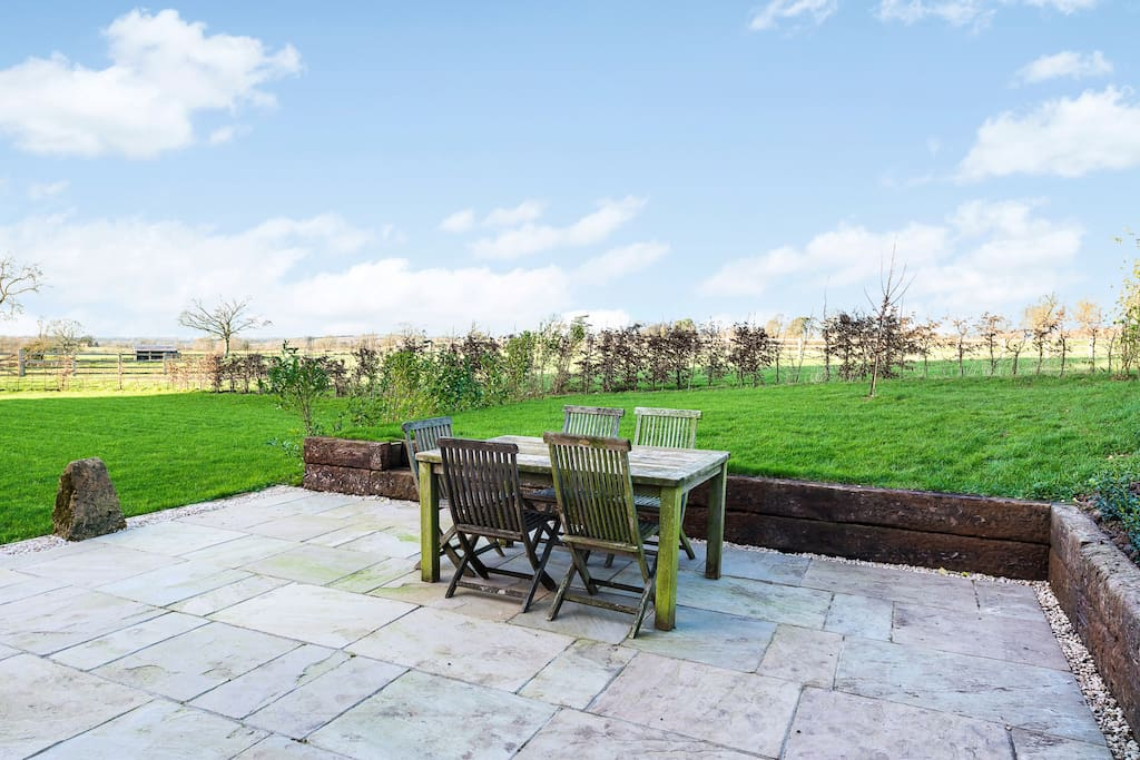 Large garden with a peaceful terraced area for alfresco dining. BBQ available