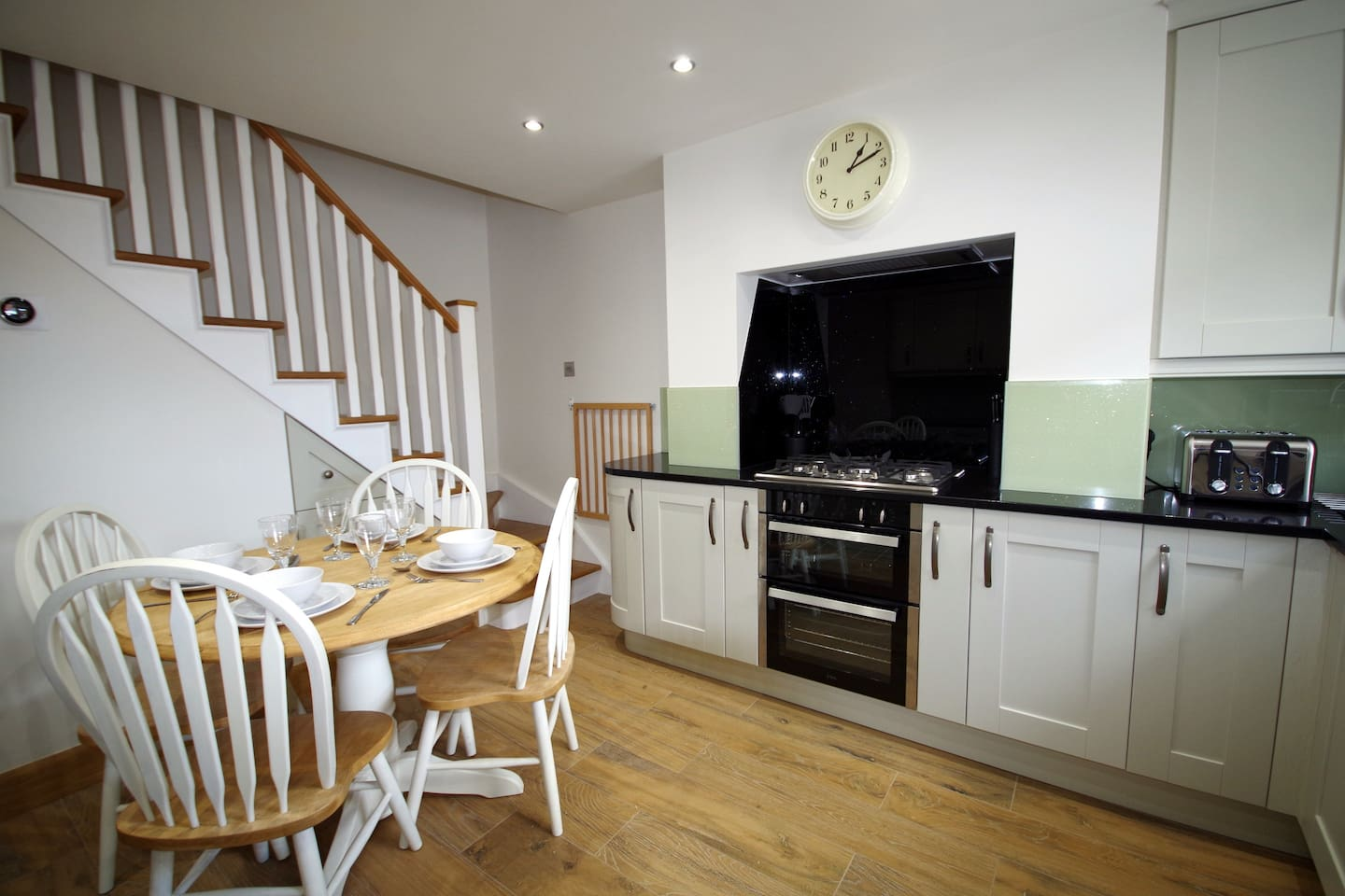 Fully fitted dining kitchen with 5 burner gas hob, electric oven & grill. Fridge, freezer, dishwasher, washer/dryer, microwave, toaster and kettle. Full range of cooking utensils, crockery, knives and forks.