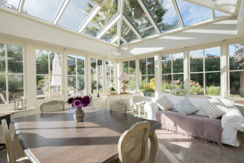 A large and spacious orangery with great views over the garden a glass covered well and underfloor heating