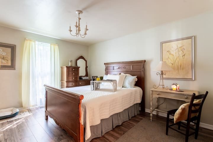 """Lovely master bedroom also has a writing desk, an armoire' and two closets with it's own entrance to the bathroom. The bed has a 4"""" padded topper for a really comfortable sleep."""