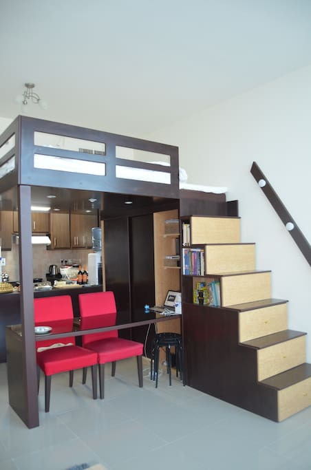 Loft unit queen size bed and working area below.