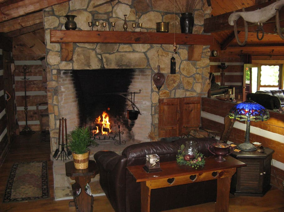Cuddle up by the massive stone fireplace