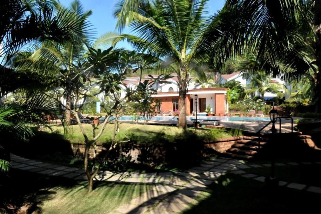 Melange Homestay surrounded in the lush green palms of Goa