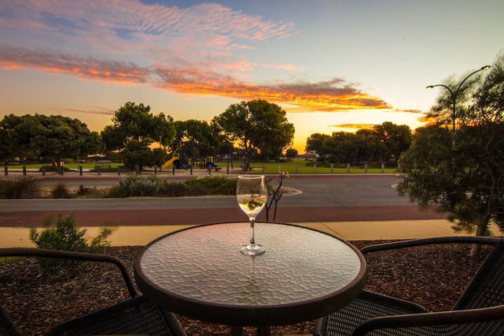 Relax with a drink and enjoy the sunset whilst the children play at the park.