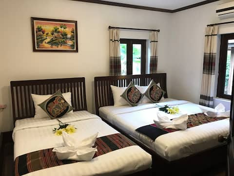Deluxe Triple Room of Thatsaphone Hotel