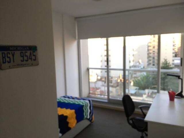 Habitación privada en moderno departamento
