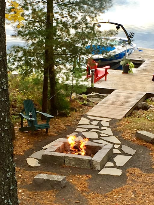 Custom outdoor fire pit leading to spacious dock; excellent swimming (no weeds), excellent fishing (bass, pike, pickerel), with gorgeous western facing sunsets.