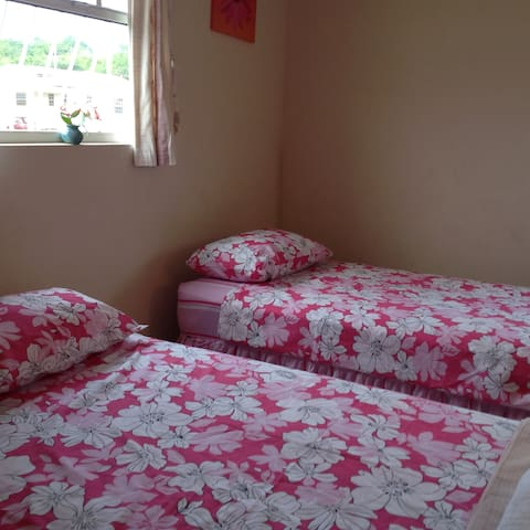 Bedroom 2, with 2 large single beds , can be configured to make a king size bed