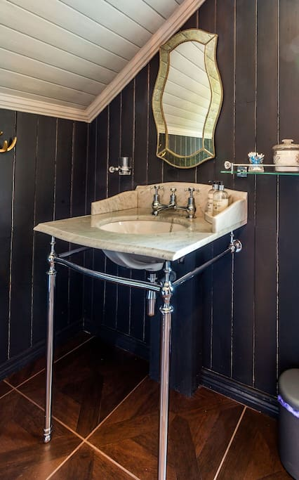 This beautiful marble topped Victorian sink is fitted with a Victorian antique mirror
