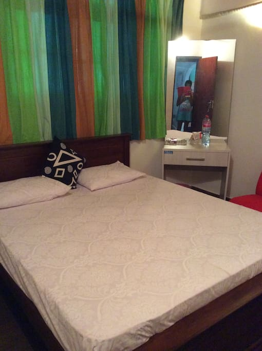 Clean white bed sheets and pillow cases and cushion Double bed with 06 inch comfy mattress for a comfortable sleep .