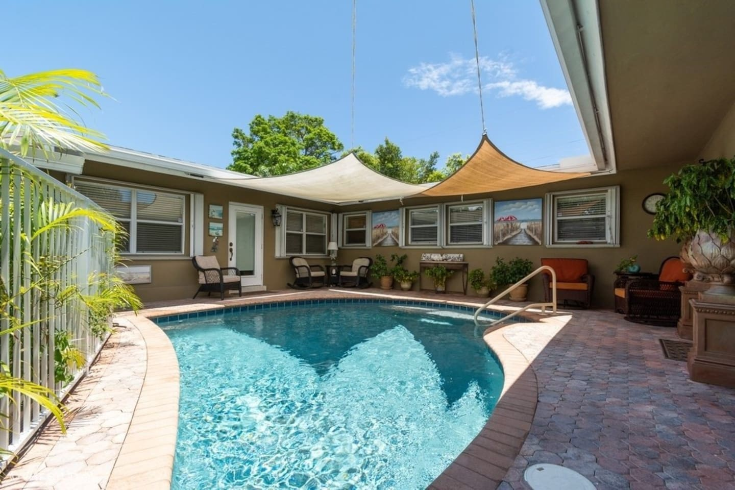 Paradise Pool with patio furniture, shaded