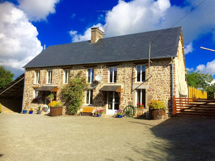 Large farmhouse with extensive grounds and views