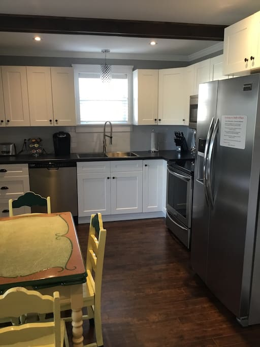 A fully equipped kitchen. Complete with stove, fridge, dishwasher, microwave, and all dishes and cookware needed to prepare simple or gourmet meals.