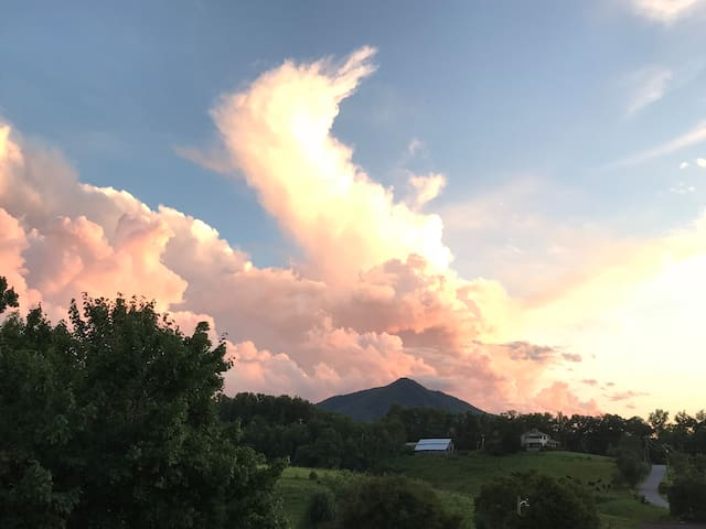 """""""This has been one of my favorite places to stay! The home was beautiful and had a breathtaking view at sunrise and sunset."""" From a Guest Review.  PHOTO: Sunset from Deck."""