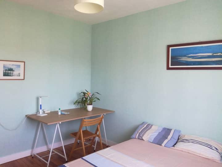 La chambre bleue de la maison aux hortensias