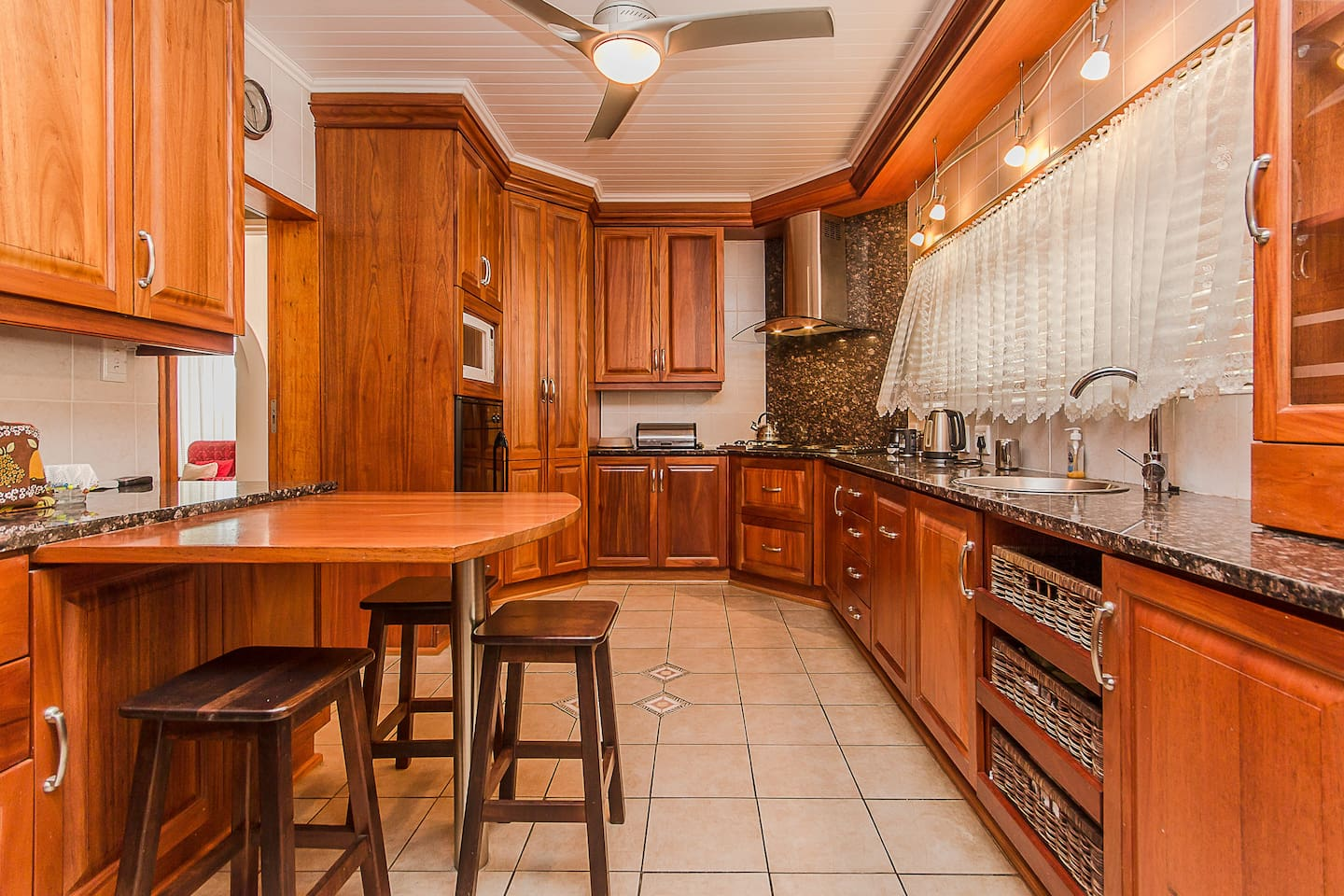 Kitchen with 4 plate stove, 2 gas hob, oven, kettle, toaster.