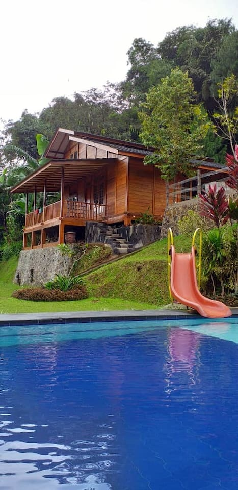 Villa Hakim 4 front view, 2 room villa with a loft situated at Curug cilember Cisarua Puncak Bogor Indonesia. Its one of the 4 Villa Hakim built on a hill slope facing the serene mount Pangrangon, and is in  the vicinity of Curug waterfalls.