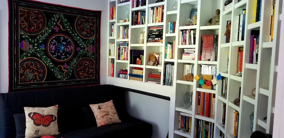 Guest Bedroom with Double bed, garden view, and Spiritual Library of over 300 books
