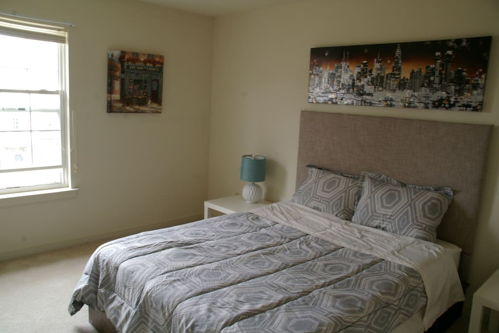 Room has ample of storage: night stand, bed frame, closet and shelf have enough space for you