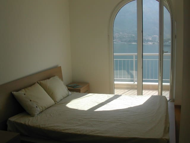 Master bedroom with sea view and balcony access