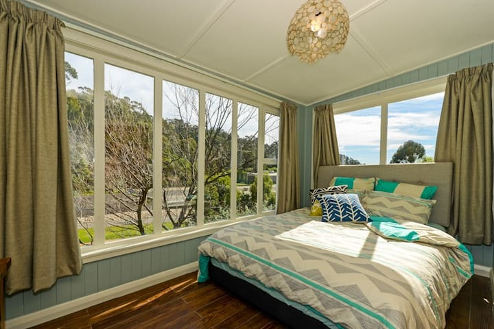 A second bedroom overlooking the walking track provides an additional Queen Size bed for larger groups.