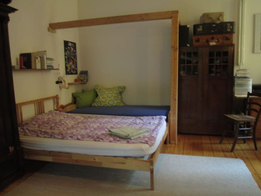 Bedroom with double bed an single bed.
