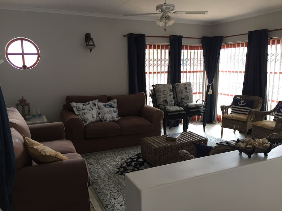Lounge, with access to the balcony and outside braai