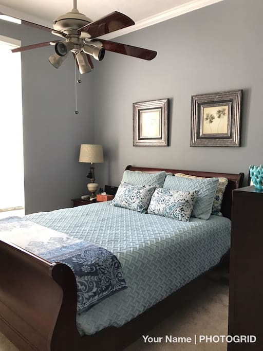 Guest Room #1 - BLUE - 10 Foot Ceilings with overhead fan, large blinds, and firm mattress.