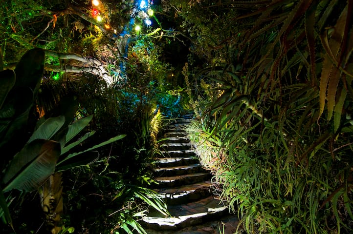 Stairs leading up to private hot tub at night