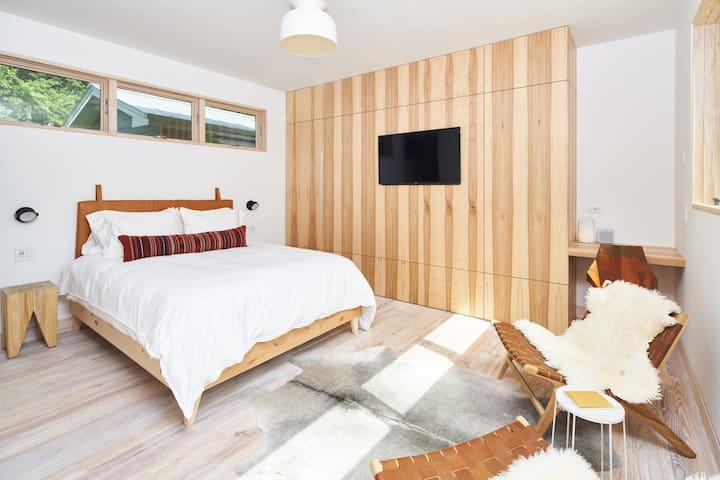 Bedroom studio suite with built-in closet and desk