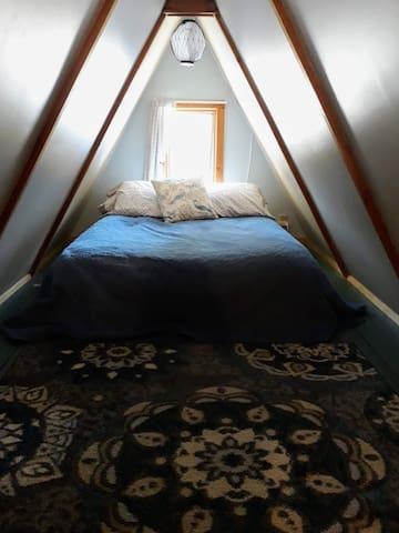 Sleeping loft with full size bed