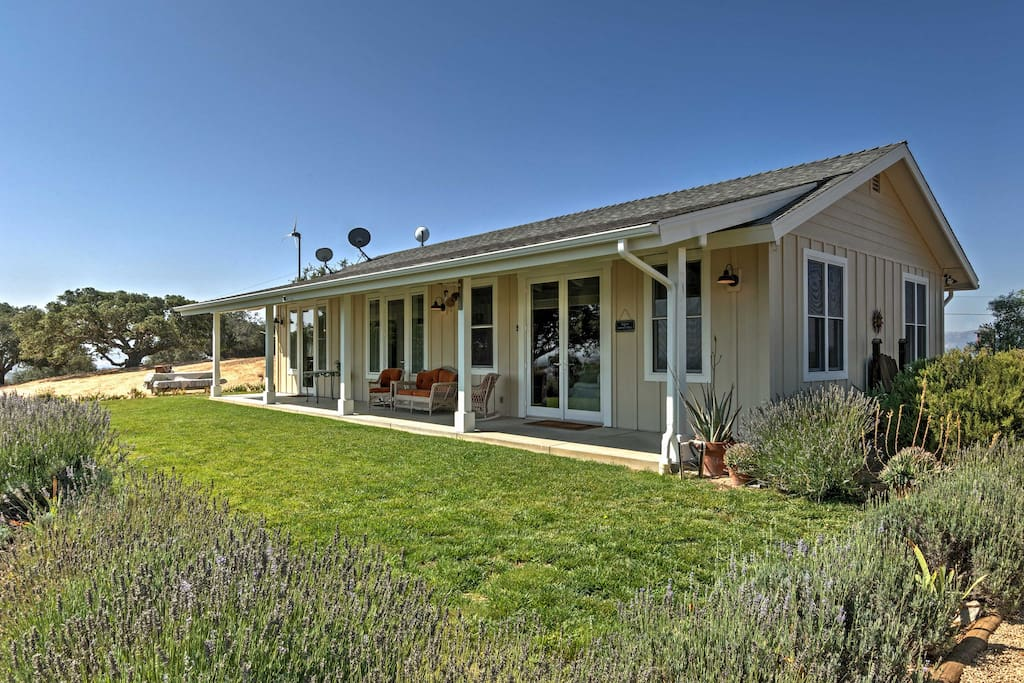 The home is situated on a private and gated, 20-acre property with 360-degree views of open country, hillsides, and grape vines.