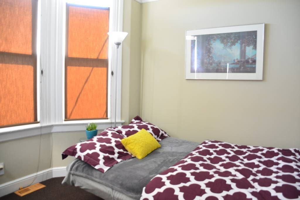 Your bedroom right next to front entrance. Beautiful morning sunlight through bay windows. Full-sized futon: super comfortable with plush memory foam topper.